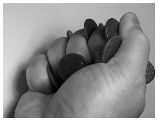 Coins clenched in hand